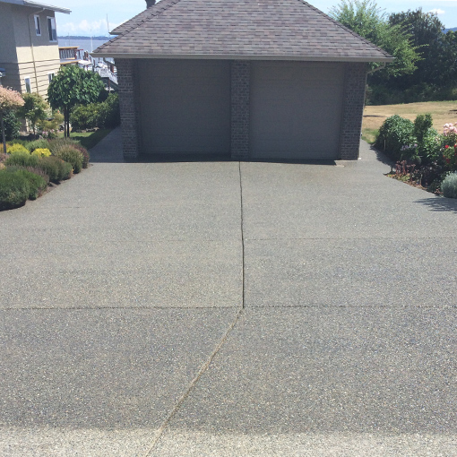 Residential driveway and sidewalk cleaning, sealing and crack repairs