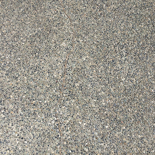 Residential driveway and sidewalk cleaning, sealing and crack repair