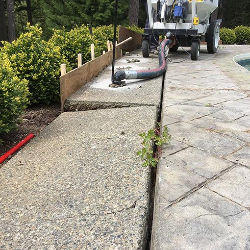 Rigid Concrete Raising and Repairs Warehouse Floor Crack Repair